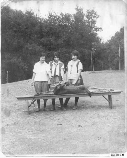 A family friend and two of my father's aunts prepare to skin a deer in 1920.